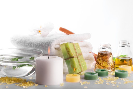 38588609 - spa still life: towels, candles, soap, massage oil